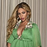 Beyonce completed her kelly green dress with gemstone hoops.
