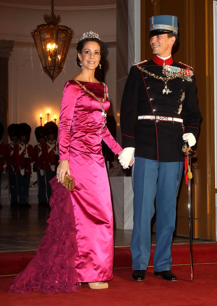 But Marie's Wardrobe Isn't For the Faint of Heart — She Takes Her Hot Pink in Satin With a Side of Ruffles