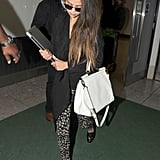 Printed leggings, like the ones Selena Gomez wore during her arrival to London, are a great way to meld comfort and style. The singer then used an elegant white Dolce & Gabbana bag to inject a fresh flair.
