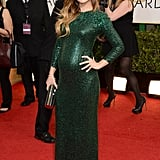 Olivia Wilde put her growing baby bump on display at the Golden Globes.