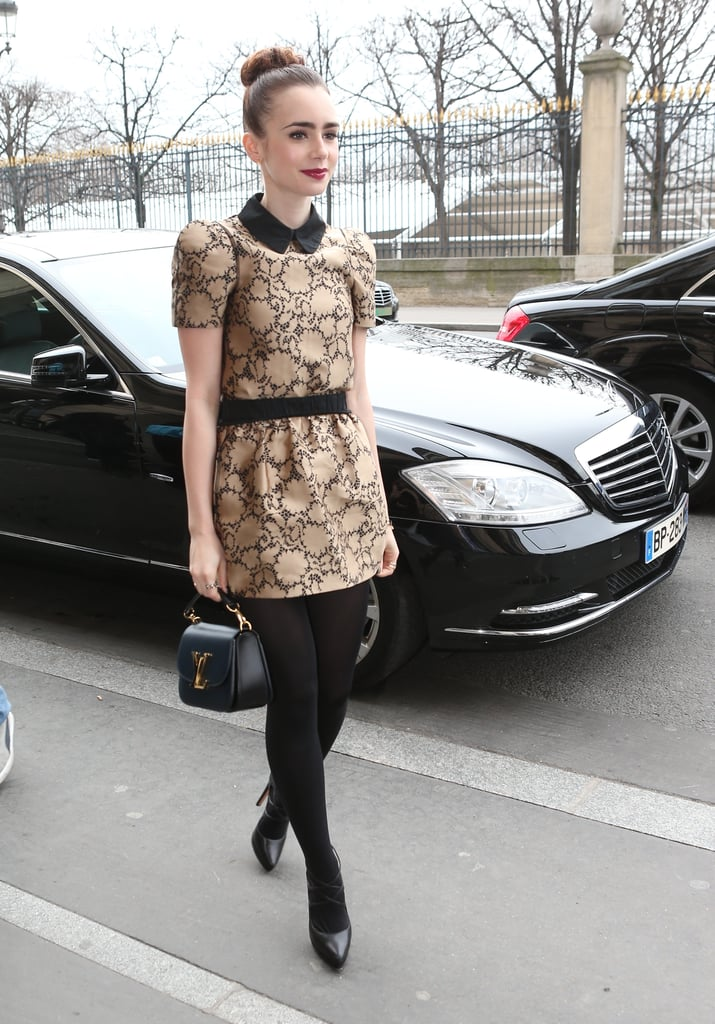 Lily Collins looked lovely in a collared minidress and mini Louis Vuitton bag en route to the Vuitton show.