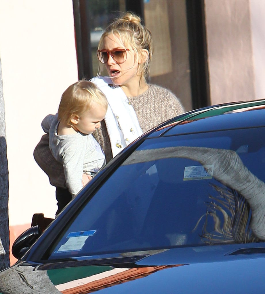 Kate Hudson wore red-rimmed sunglasses and carried Bing out of an LA restaurant.