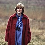 Diana was all about the layers on this particular afternoon, putting a red button-up coat over a blue high-collared dress that goes with anything. The perfect accessory for watching polo? Binoculars, of course.