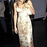 A Floral Spaghetti Strap Dress With a Mini Shoulder Bag