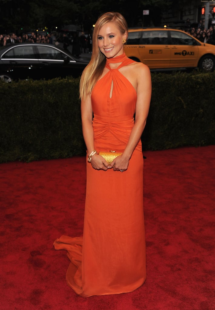 Kristen Bell brightened up the carpet in an orange gown.