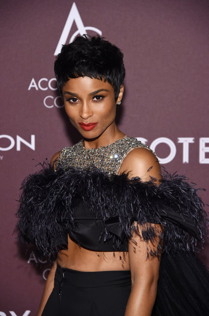 """Ciara has been experimenting with her hair quite a bit lately, but she just made an unexpected plunge and chopped her hair into a pixie cut. At the Accessories Council's 23rd Annual ACE Awards, the singer arrived with a short new textured look that showed off her gorgeous cheekbones.  She posted an image of her glamorous new style to Instagram, where she captioned the new style, """"Chop it awf 😘,"""" referencing her haircut. The hair is especially shocking considering many of her recent red carpet looks have involved long and voluminous curls and locs. Ciara has proved she can pull off anything. Check out her new hair from every angle, ahead."""