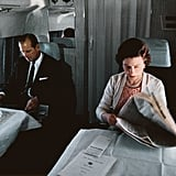 Queen Elizabeth II reading papers on a plane in 1969