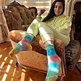 Styling tie-dye socks with a neon yellow Aerie sweatsuit.