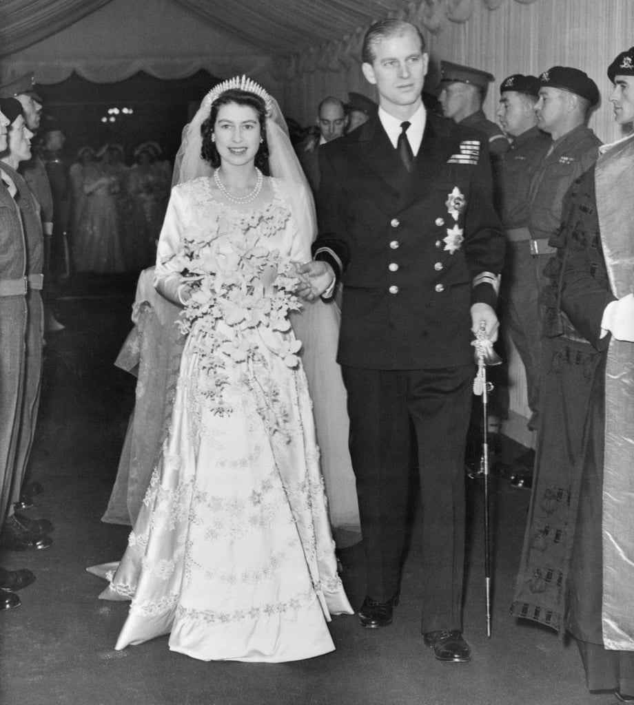"Their union was frowned upon by many. Queen Elizabeth II and Prince Philip, who are actually cousins, didn't have an easy journey to the aisle. Due to Philip's arrogance and lack of funds, it was widely considered that the future Queen should pick another suitor. Fortunately Elizabeth ignored the doubters, and moved forward with the wedding. Prince Philip planned a sweet proposal. While walking around the grounds of Balmoral Castle (in Scotland), Philip popped the question. Since Elizabeth's parents didn't approve at the time, they had to keep it a secret for quite a while. The Queen's engagement and wedding rings are both stunners. Prince Philip proposed with a 3 carat diamond and platinum engagement ring crafted by Philip Antrobus. The jewelry company took diamonds from a tiara belonging to Prince Philip's mother, Princess Andrew of Greece, adding a special familial touch. For her wedding ring, a nugget of Welsh gold from the Clogau St David's mine, near Dolgellau, was used. Philip had not one, but two bachelor parties. Or ""stag parties,"" as they're called in the UK. The night before the wedding, Philip hosted a party at the Dorchester open to the press, who were invited to cover the protocol of the day. It reportedly got a little out of hand: Philip and his friends ended up ripping the flashbulbs off of a few cameras and stomping them on the ground before moving on to a private stag party at London's Belfry Club."