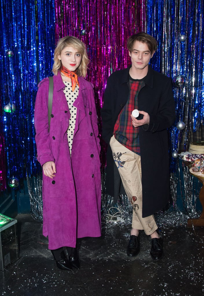 Natalia Dyer and Charlie Heaton may be the couple we never saw coming but we simply can't get enough of seeing the pair out and about, particularly when they're in London looking superstylish. The on-and-off screen duo were recently spotted at the Burberry x Cara Delevingne Christmas Party partying alongside the likes of Rita Ora and Suki Waterhouse. Natalie sported polka dots under a purple trench on the night, while Charlie matched host Cara, dressed in tartan.   The Stranger Things stars have recently spent lots of time in London, even double dating with Maisie Williams and her boyfriend. But now that we know Charlie is actually British, it makes sense that the pair are spending more time in the city. Seriously, how is his American accent that convincing? Keep reading for more snaps of the couple at the fashionable event.       Related:                                                                                                           You Can See the Stranger Things Cast in Other Things Before Next Season