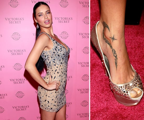 Adriana Lima has a tribal design and shooting star tattooed on the inside of her right ankle.