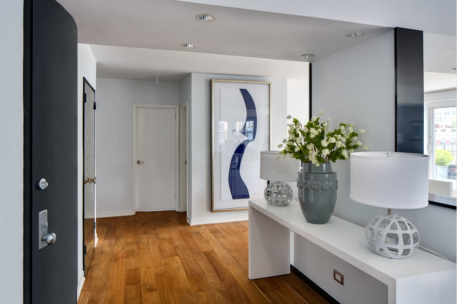 The entryway is currently decorated in a modern minimalist style.