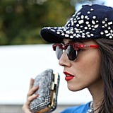 A baseball hat brimming with sequins and rhinestone-embellished red shades meant real fashion fun.
