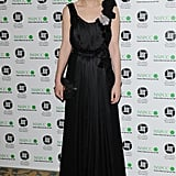 At the 2010 London Critics' Circle Film Awards, Carey Mulligan exuded ladylike elegance in a rosette-detailed Nina Ricci gown, diamond drops earrings, and a black satin clutch.