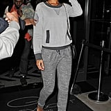 Topping her sporty-chic sweats with a charcoal-trim sweater, Rihanna chose this get-up-and-go combo for a New York night in 2012.