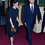 In April 2018, Meghan wore this simply stunning Stella McCartney cape dress with a Naeem Khan zodiac clutch, Isabel Marant hoop earrings, and suede Manolo Blahnik pumps for a concert at Royal Albert Hall to celebrate the queen's 92nd birthday in London.