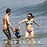 Alyson Hannigan and her husband, Alexis Denisof, fooled around in the water with their daughter.