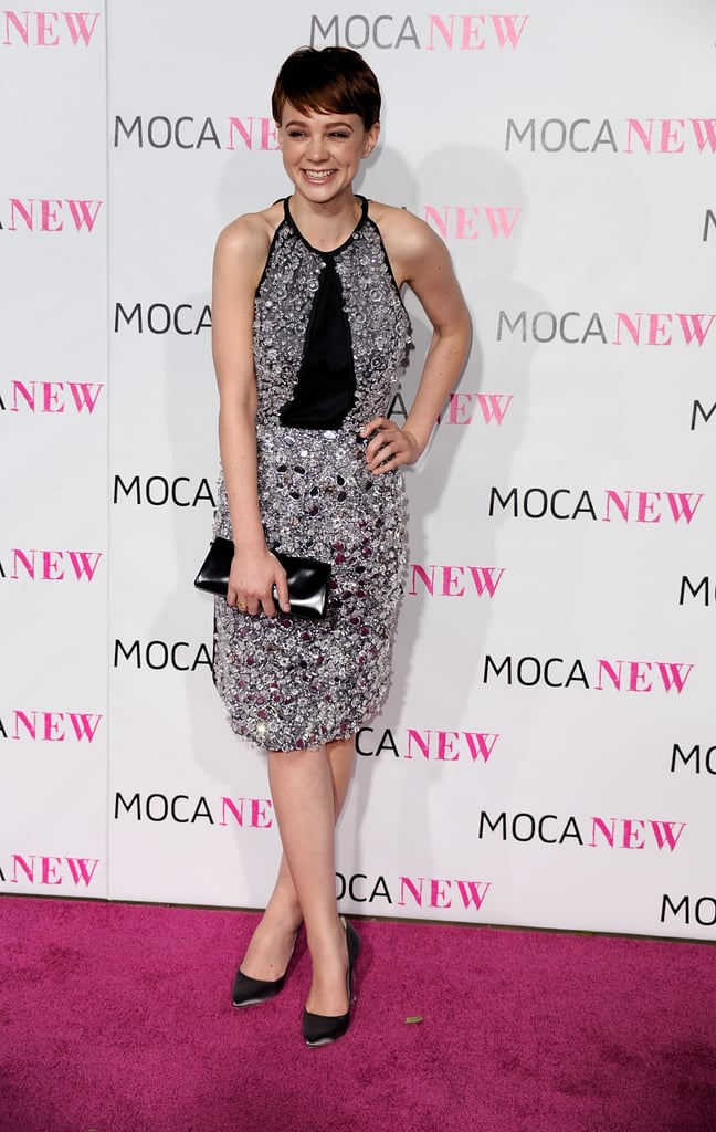 For the MOCA 30th Anniversary Gala, Carey chose an all-over crystal embellished Prada Halter, satin black pumps, and a patent leather letter clutch.