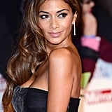 At the Pride of Britain Awards in 2013, Nicole swept her long, glossy curls over one shoulder and focussed attention on the eyes with false lashes and taupe shadow, plus nude lipstick.