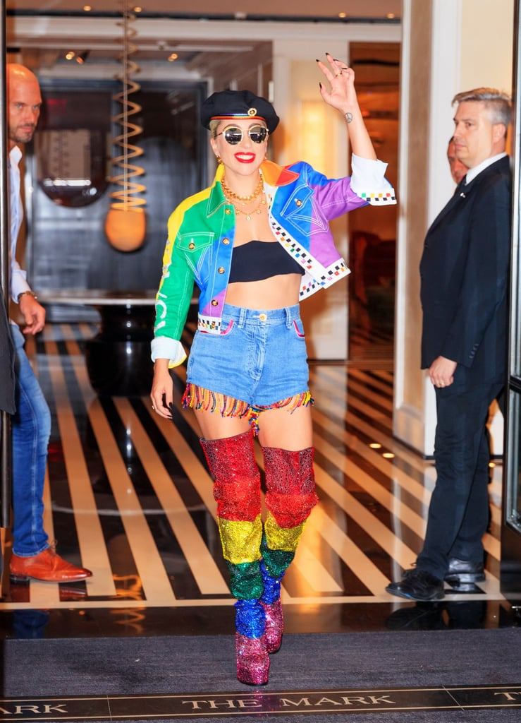 Lady Gaga wearing a custom moto jacket, fringed shorts, and thigh-high boots.