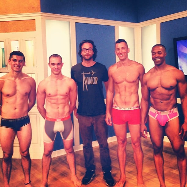 One of these things is not like the other — Chris D'Elia got in the middle of a shirtless sandwich on the set. Source: Instagram user chrisdelia