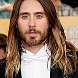 POPSUGAR: Before the Oscars, we polled our readers to see how Jared should wear his hair. The options were beach waves, ponytail bun, or the wet look. The results: 45 percent picked waves, 42 percent picked an updo, and 13 percent said the wet look. Our readers had it right! So how did you and Jared reach this monumental decision? Chase Kusero: We've definitely been experimental, and that's been a key to his hair looking great. He likes to have his style unique to the moment. We did ponytail bun for Golden Globes, and if we did it again, it would seem [old]. We did the Indie Spirit Awards the night before, so he started with product in his hair, and then he slept on it. When he put his jacket on, we knew it had to be down for an iconic vibe. We knew that was it.  PS: What are some tips you can offer our readers to get Jared's undone beach waves at home? CK: We did subtle things, and it just worked. Yesterday was a big day for him, so his hair was kind of an afterthought. Washing the hair less is the key. Using some sort of wave-enhancing shampoo will add more moisture. That has been the key: moisturizing the hair allows it to hang well, have shine, and separate. The more moist the hair is, the more it can wave. Use a flat iron to bend 10 pieces, and it will give it that separation and make it feel undone. But we never use a curling iron or anything on Jared, or it will look too much like glam waves. Straight ends are also the key. Don't go all the way down with the hair iron to keep ends straight. It will make it look more disheveled. PS: You have said that he doesn't and will never wear extensions. What are some natural tips for growing hair long? Does he get routine trims or eat certain foods? We heard he is a vegan. CK: In the case of a female client, trimming is more of a necessity. When we started the process of growing out his hair, he left it in my hands. So we wanted it to get to a certain point so it doesn't look cut. Trimming it to make it grow is a myth. Yes you need to cut off dead ends, but doing less is better. Not doing color as often, getting less haircuts, washing it even less are all good for the growing process.