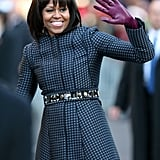 Michelle Obama waved as she and Barack walked the inaugural parade route.