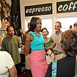 Wearing an Ann Taylor tank and carrying a Jason Wu for Target handbag at a local bakery in Virginia in 2010.