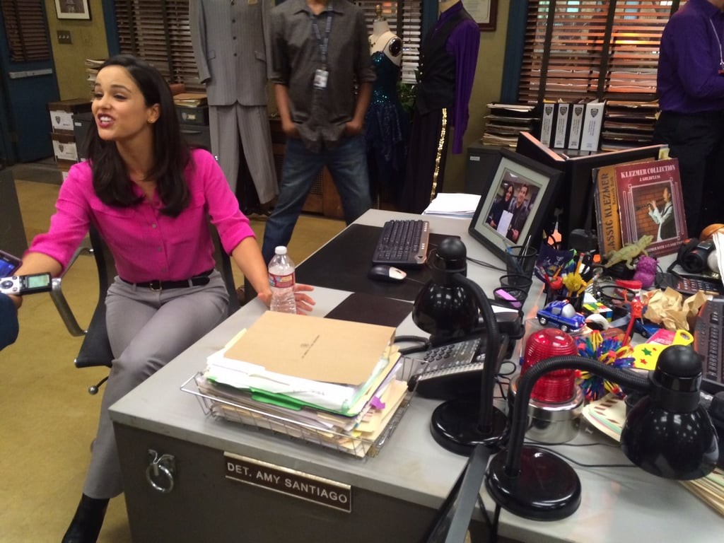 Melissa Fumero, aka Detective Amy Santiago, sat at her desk and answered questions about the show.