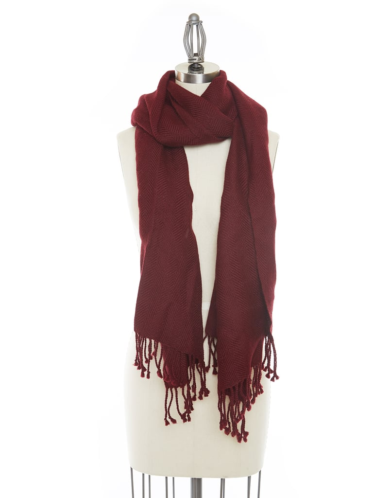 This cozy scarf ($100) is handwoven using soft alpaca and colored using natural dyes.