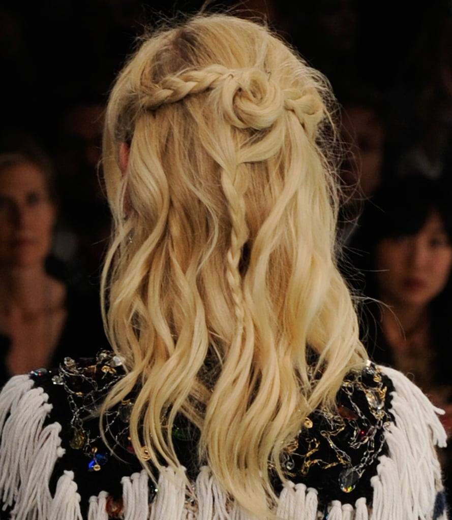 A rose shape was created with the models' hair to join the braids. And to finish the look, Gilbert dabbed on Frizz-Ease Hair Serum to add the slightest bit of polish.