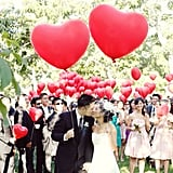 Heartfelt Valentine's Day Wedding Inspiration Forget cupids with arrows and saccharine red on pink color palettes, having a Valentine's Day-inspired engagement shoot or wedding can be whimsically romantic when done creatively and with a sense of humor. With just the right amount of sweet and some big, red hearts tossed in the mix, these inspiring wedding and engagement pics will have you in the mood for love in no time. Photo by Youkeun Oh Photography via Style Me Pretty