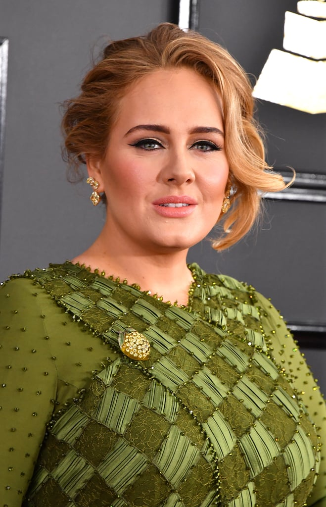 "When Adele took the red carpet at the 2017 Grammy Awards, we immediately noticed her flawless hair and makeup. The singer, who is dominating the top categories of this year's awards, rocked her signature cat eye. With its razor-sharp edges, we aspire to copy her wings every day. Adele's rosy cheeks and light pink lips perfectly complemented her olive green dress without distracting from her smouldering eye makeup. The ""Hello"" singer finished off her look with a glam updo. Her honey-blond locks framed her face and cascaded to one side for an effortless look, perfect for weddings.   Keep reading to see her classic style from every angle!"