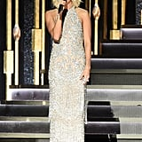 Carrie wore a shimmering halter fringe gown by Jovani Signature.