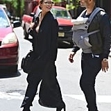 John and Chrissy were all smiles while walking with Luna in NYC in May.