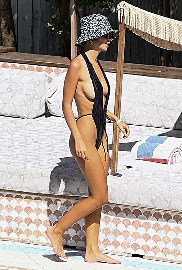 Emrata Jazzes Up Her Sexy Black Swimsuits With Leopard Print
