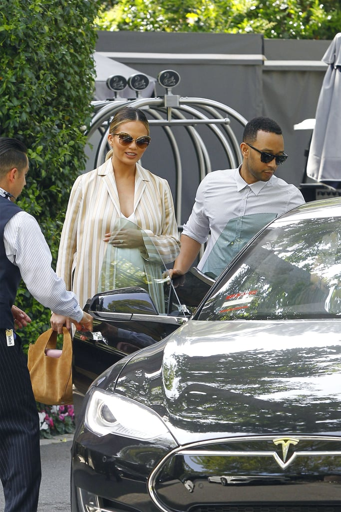 Chrissy Teigen seemed to be in good spirits when she stepped out for lunch with husband John Legend at Hotel Bel Air in Beverly Hills on Sunday afternoon. The model, who is expecting a baby girl, glowed in a sexy body-hugging dress complete with a striped coat, proving once again that she isn't letting pregnancy mess with her style game. At one point, John even put his courtly manners on display, opening the car door for his wife and waiting for her to get inside. We've seen the couple on more than a handful of cute outings together recently. Just a day before, Chrissy flaunted her bare belly during a shopping trip with John and her mom! Keep reading for more photos, and then check out Chrissy's best pregnancy snaps.