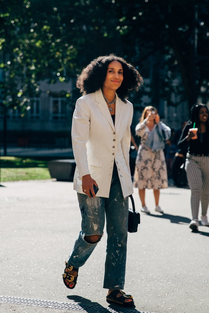 Trade out suit pants for distressed denim and predictable footwear for summer-friendly sandals.