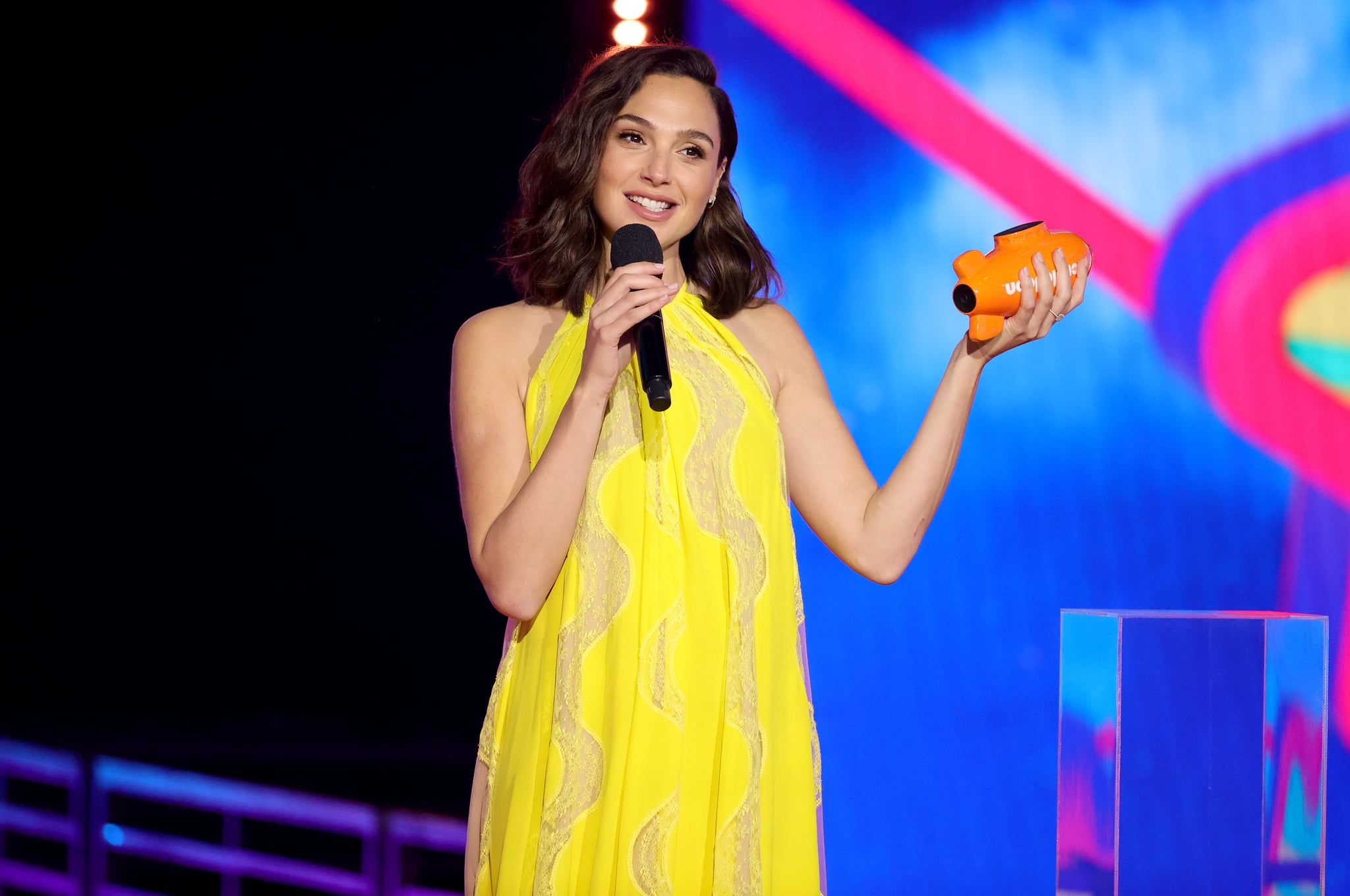 SANTA MONICA, CALIFORNIA - MARCH 13: In this image released on March 13, Gal Gadot speaks onstage during Nickelodeon's Kids' Choice Awards at Barker Hangar on March 13, 2021 in Santa Monica, California. (Photo by Rich Fury/KCA2021/Getty Images for Nickelodeon)