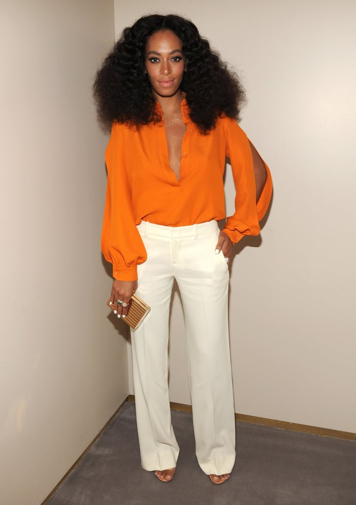 Solange made a big statement at the Chime For Change anniversary gala in a bright orange blouse.