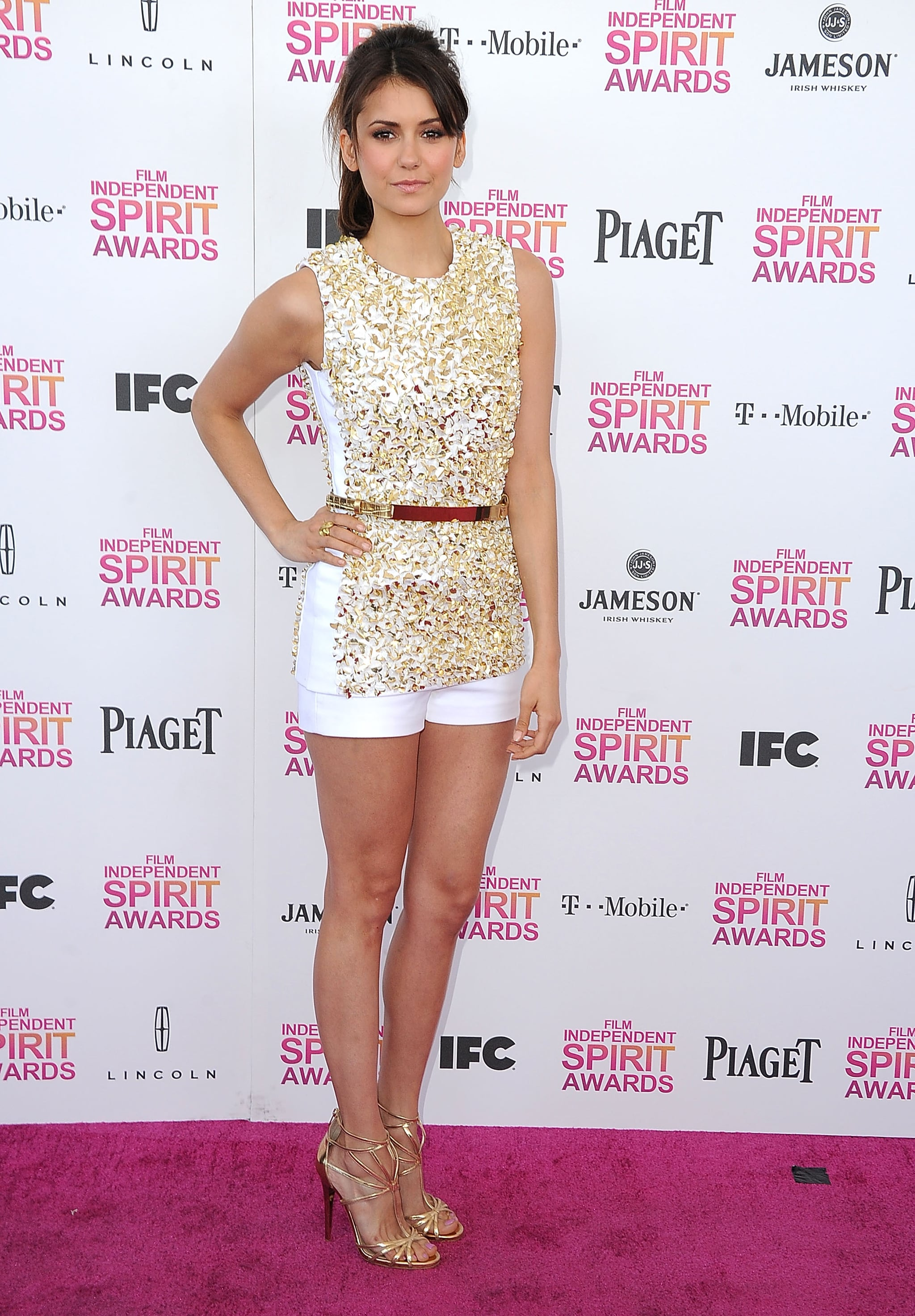 Nina Dobrev chose a short and sweet guilded Michael Kors duo for the 2013 Independent Spirit Awards in Santa Monica.