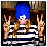 Cara Delevingne showed her silly side in a blue beanie and striped top. Source: Instagram user caradelevingne
