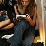 An engrossed model couldn't put her book down before the Kai Kuhne, Myself Spring 2006 fashion show during Olympus Fashion Week.
