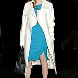 Jessica Chastain brightened up her nighttime ensemble with a bright teal dress, then added a wintery white Michael Kors wool coat and nude peep toes.