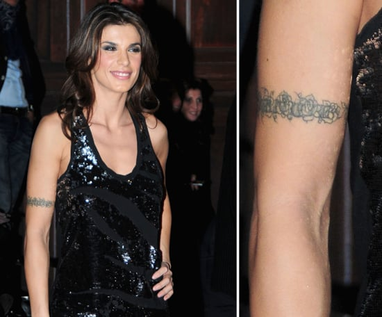 "Elisabetta Canalis, George Clooney's former love, got an ""Eminem"" tattoo around her bicep in 2001 — she wanted one just like Em himself had! She covered up the rapper's name with a rose barbed wire design since then."