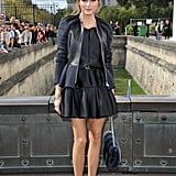 Olivia Palermo wasn't afraid of a little ruching, as evidenced by her Christian Dior ensemble at the label's show. A sweet low bun, fur chain-strap bag, and a black pumps completed the look.