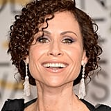 Choosing metallic lilac shadow and a glossy nude pout, Minnie Driver proved she's still ahead of the trends.