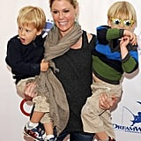 Julie Bowen held her two boys, John and Gus, before going inside to enjoy the event.