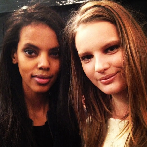 It was all about the soft smoky eyes and side parts backstage at BCBG Max Azria.
