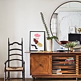 We love how the actress puts a modern spin on a space using supereclectic pieces, like this Gothic chair and a credenza that screams 1950s chic.